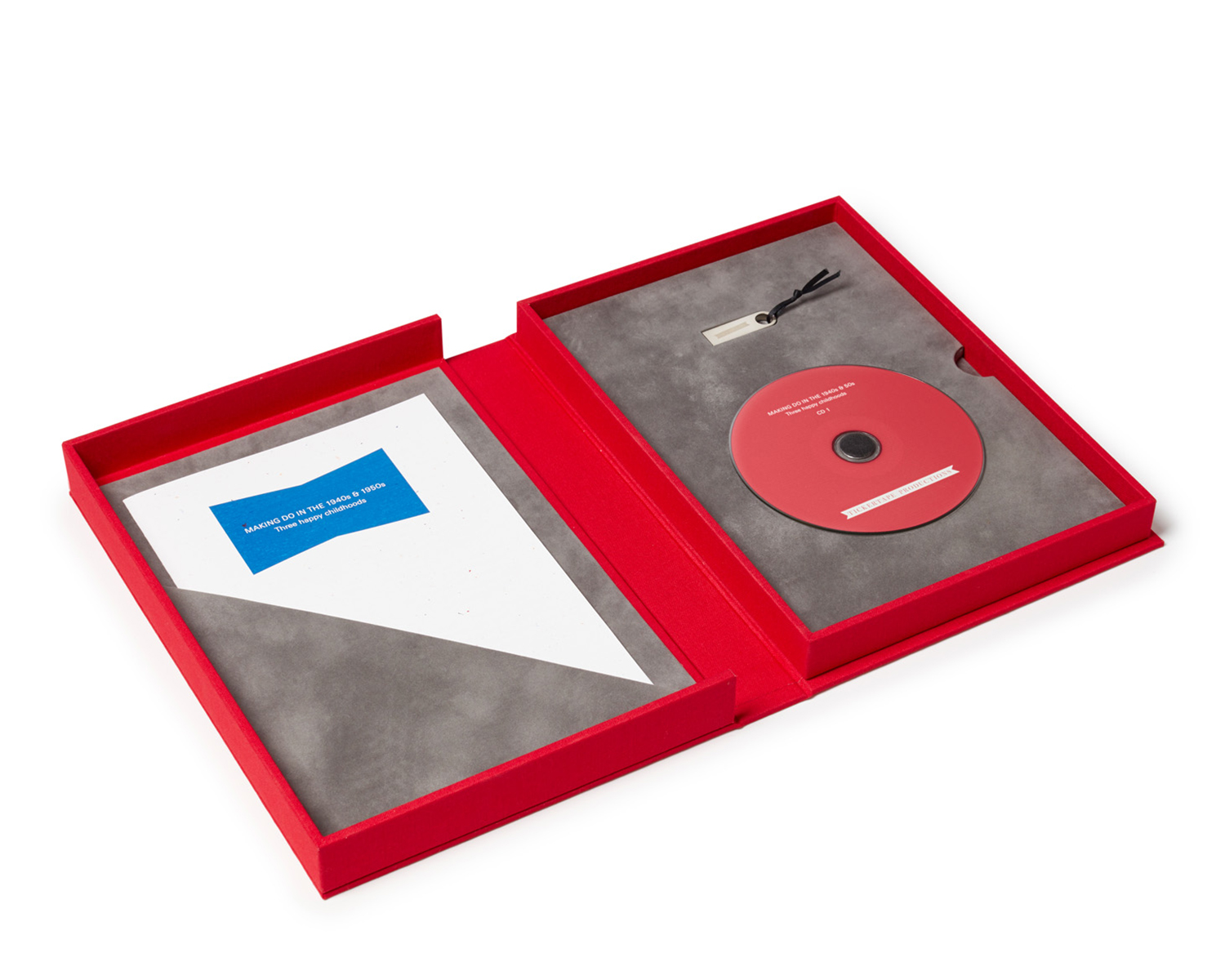 Suedette-lined interior of a Spoken Portrait presentation box: audio CD, USB stick and paper insert with a summary of contents
